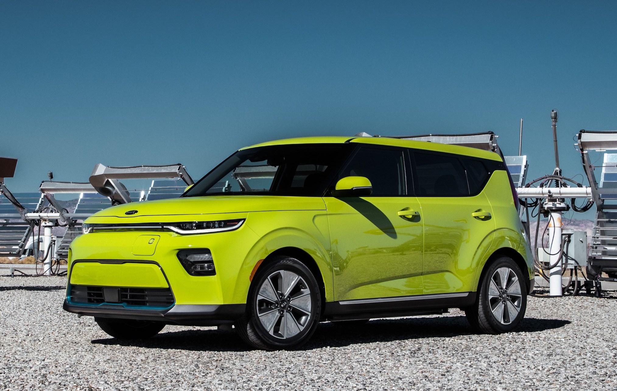 A lime-green 2020 Kia Soul EV, a small electric hatchback.