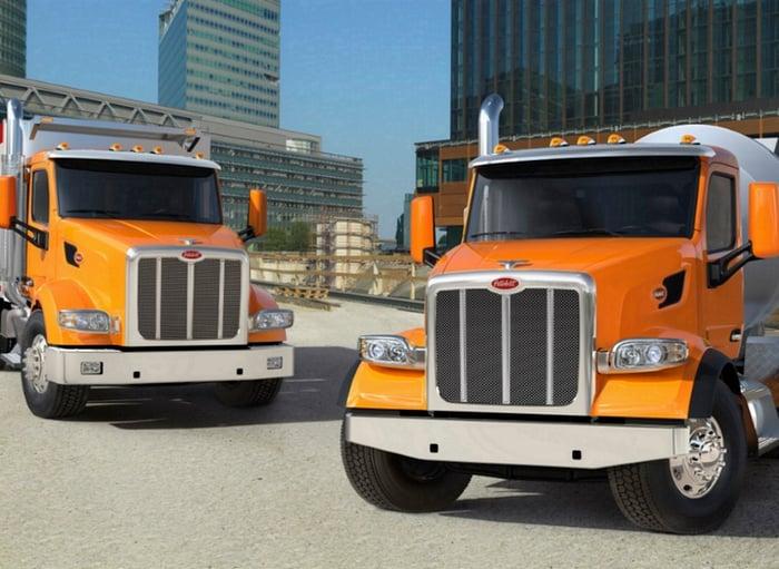 Two heavy-duty semi trucks parked.