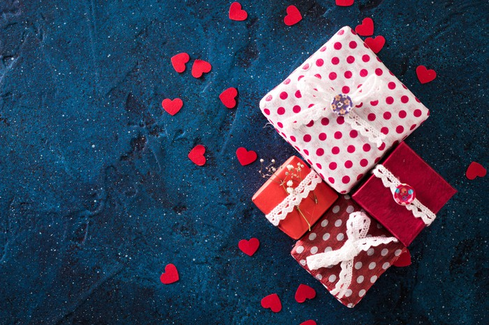 Four wrapped presents surrounded by hearts.