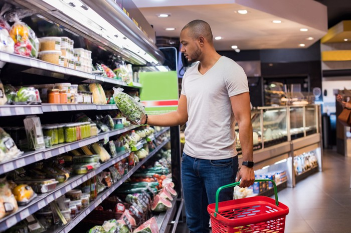 A man shopping for food at a grocery store