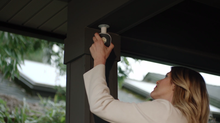 Woman installing Arlo security light