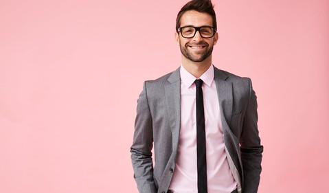 smiling man in suit_GettyImages-857345762