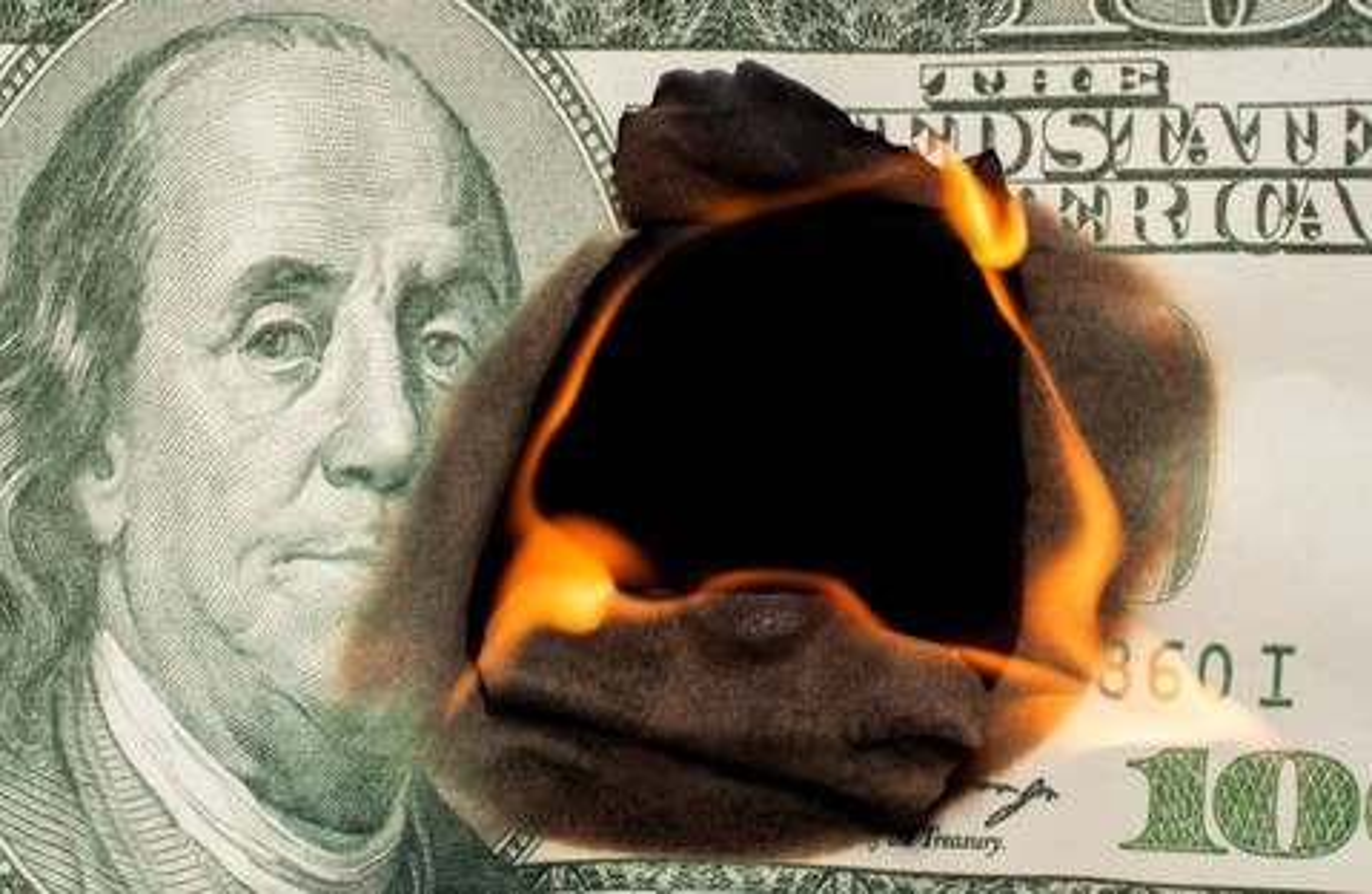 Hundred Dollar Bill on Fire Losing Money Investment Debt Credit Getty