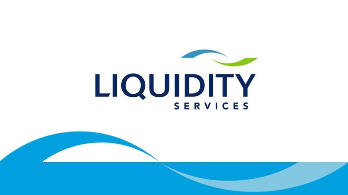 Liquidity Services logo, consisting of a wave-shaped graphic against a rectangular background.