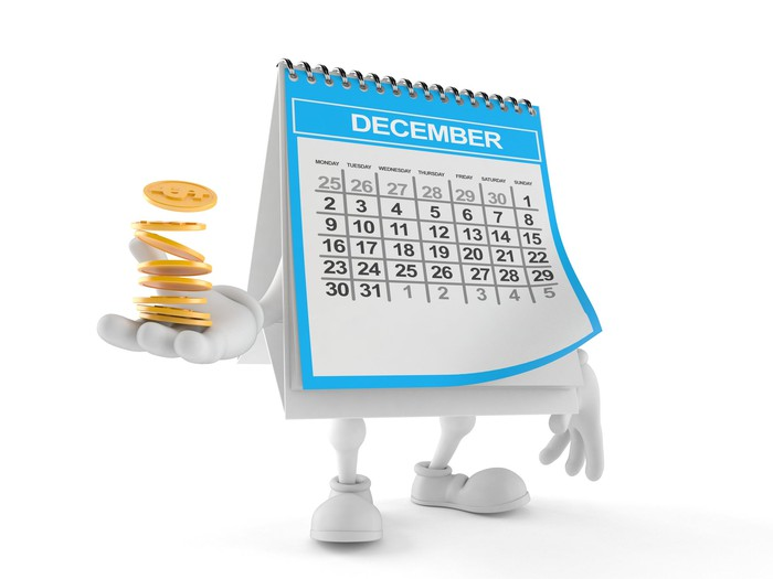 December calendar with legs and arms holding a stack of gold coins