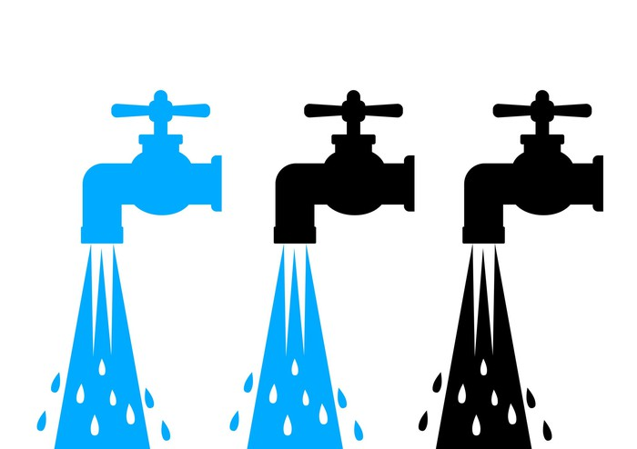 Silhouettes of three running water faucets