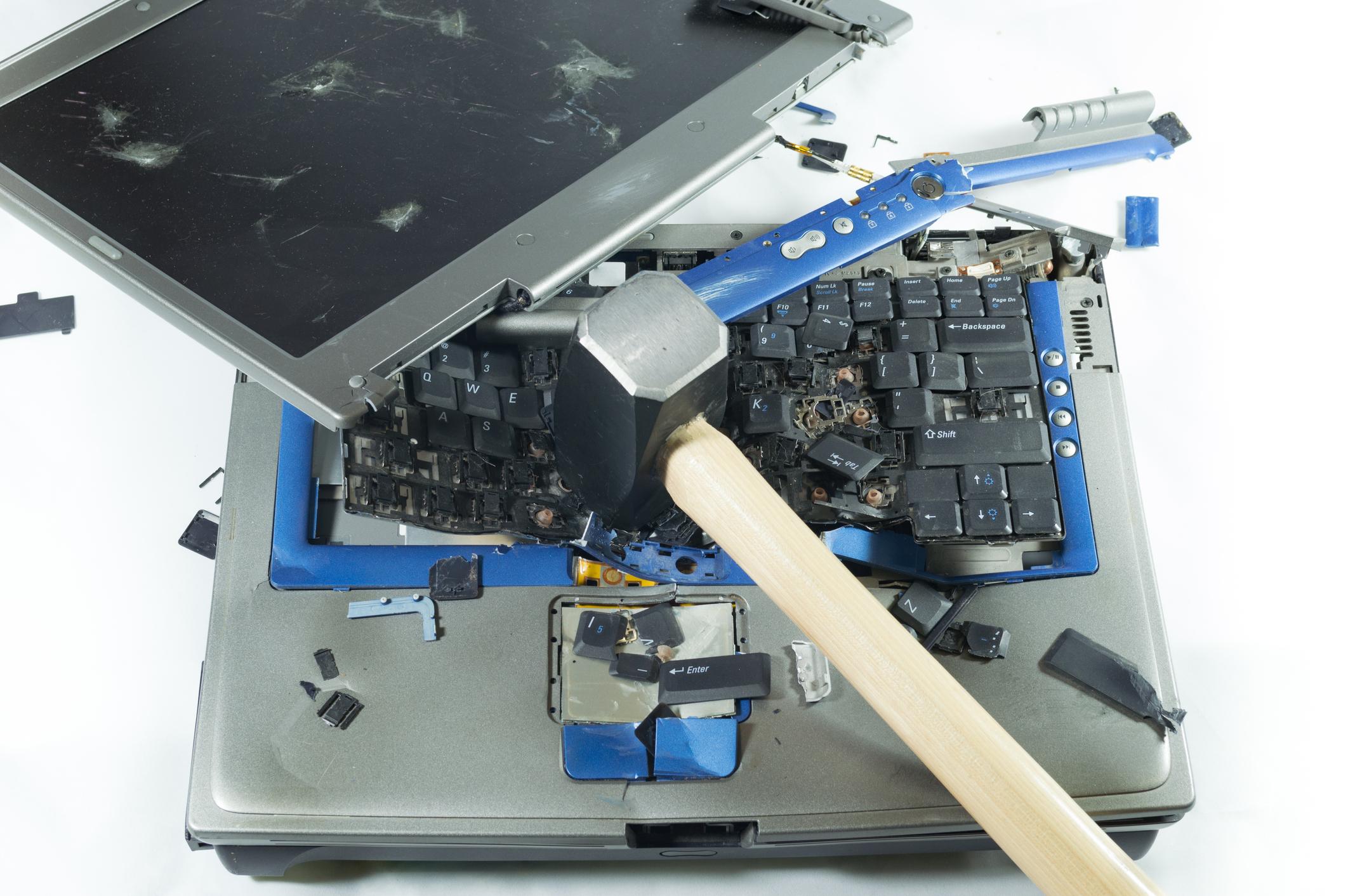 Sledgehammer breaking a computer