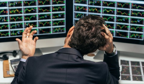 frustrated-stock-traders-multiple-charts-forecasting-getty