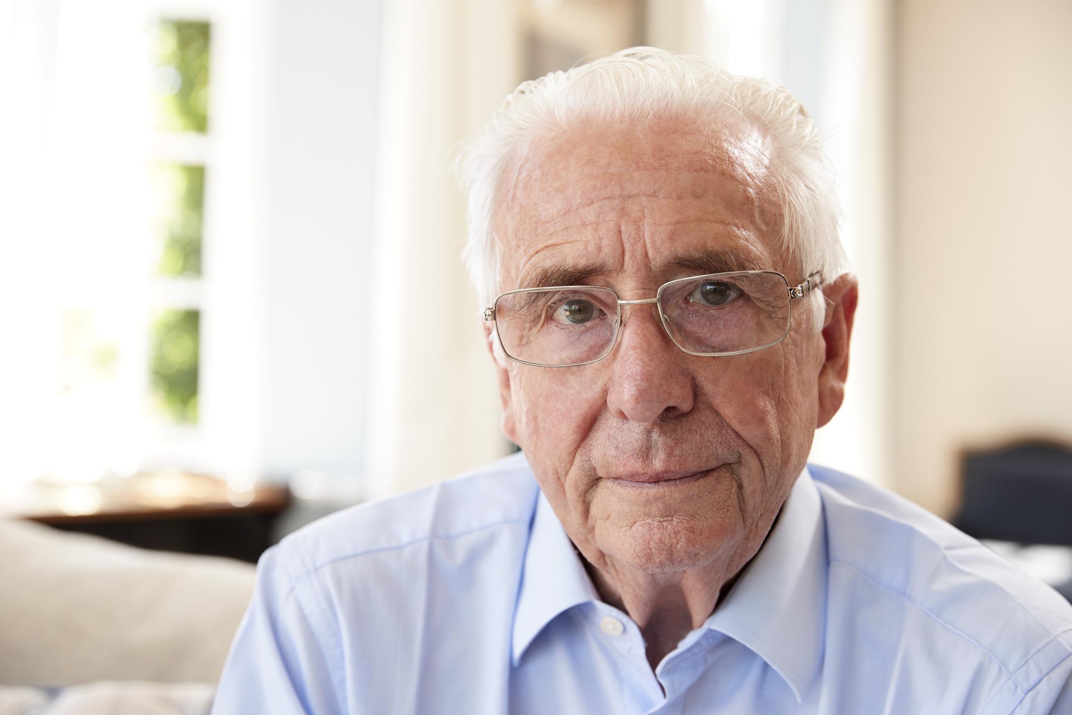 Older man with sad expression