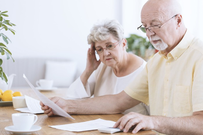 Older man and woman looking at papers