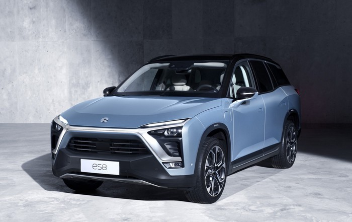 A blue-gray NIO ES8, a three-row seven-passenger electric SUV.