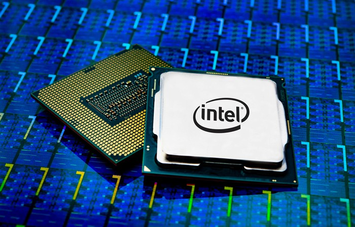 Two fully-packaged Intel desktop CPUs on a wafer of CPU dies.