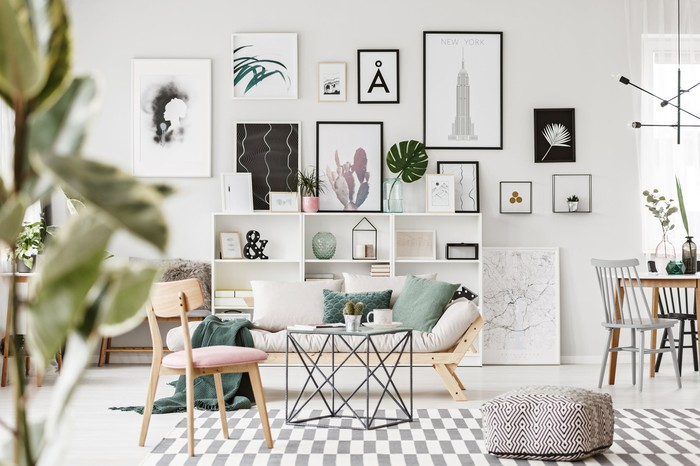 Framed prints on a living room wall.