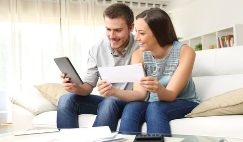 couple reviewing paperwork_GettyImages-623211758