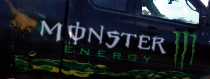 Photo of a truck door emblazoned with the Monster Energy logo.
