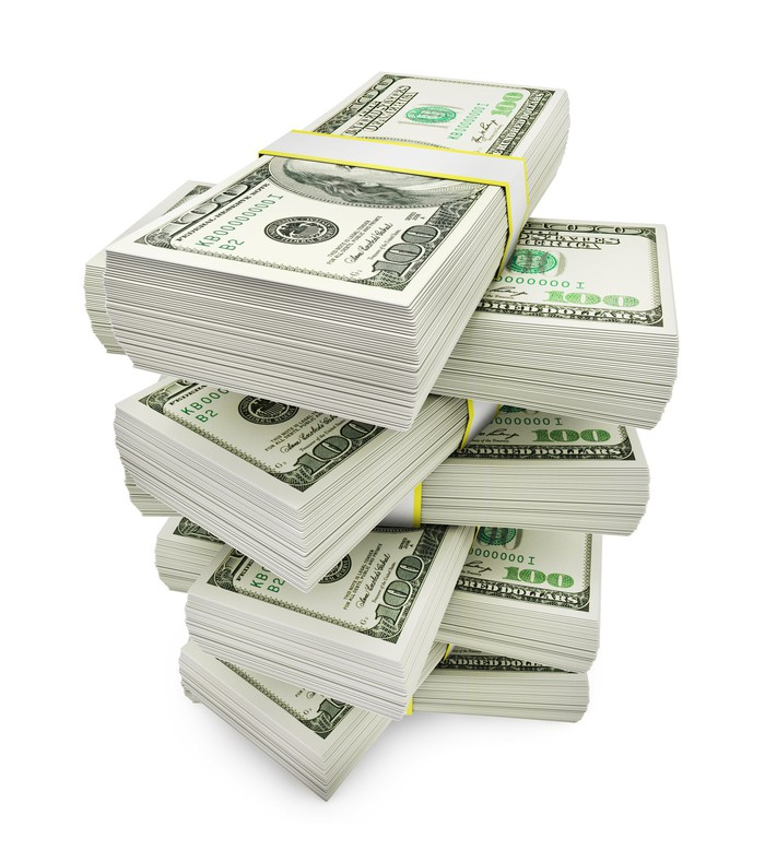 Stack of eight thickly bundled $100 bills on top of the other in a crisscross pattern