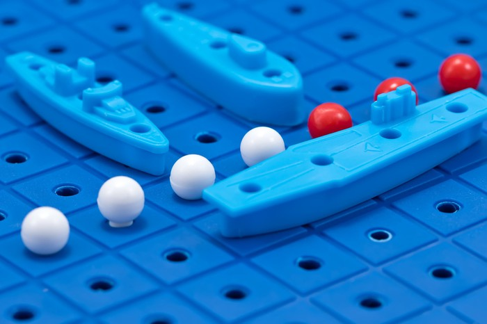 Closeup of pieces on a Battleship board game