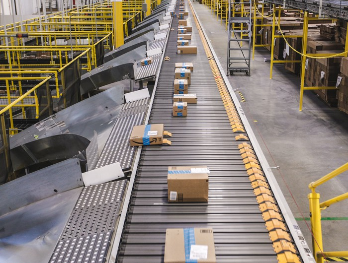 Boxes on a conveyer belt in an Amazon fulfillment center.