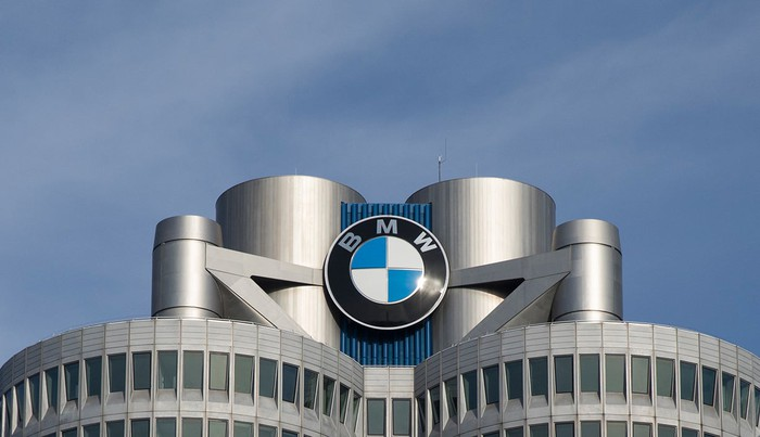 "A close-up of the BMW ""roundel"" logo atop the company's headquarters building."