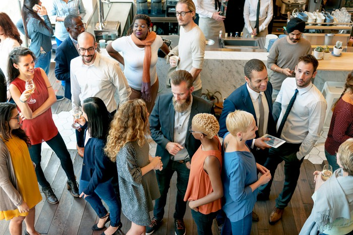 People mingle in a business casual setting.