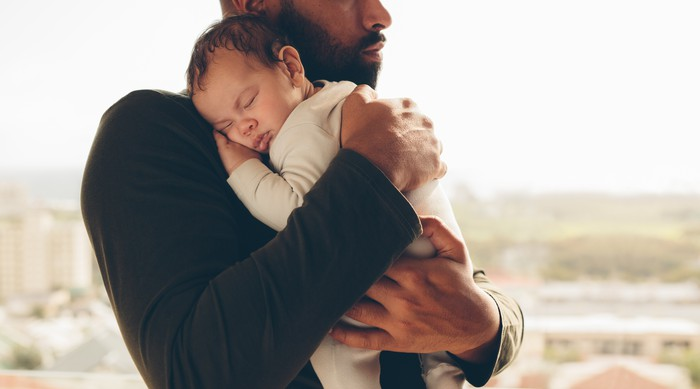 A man holding a baby