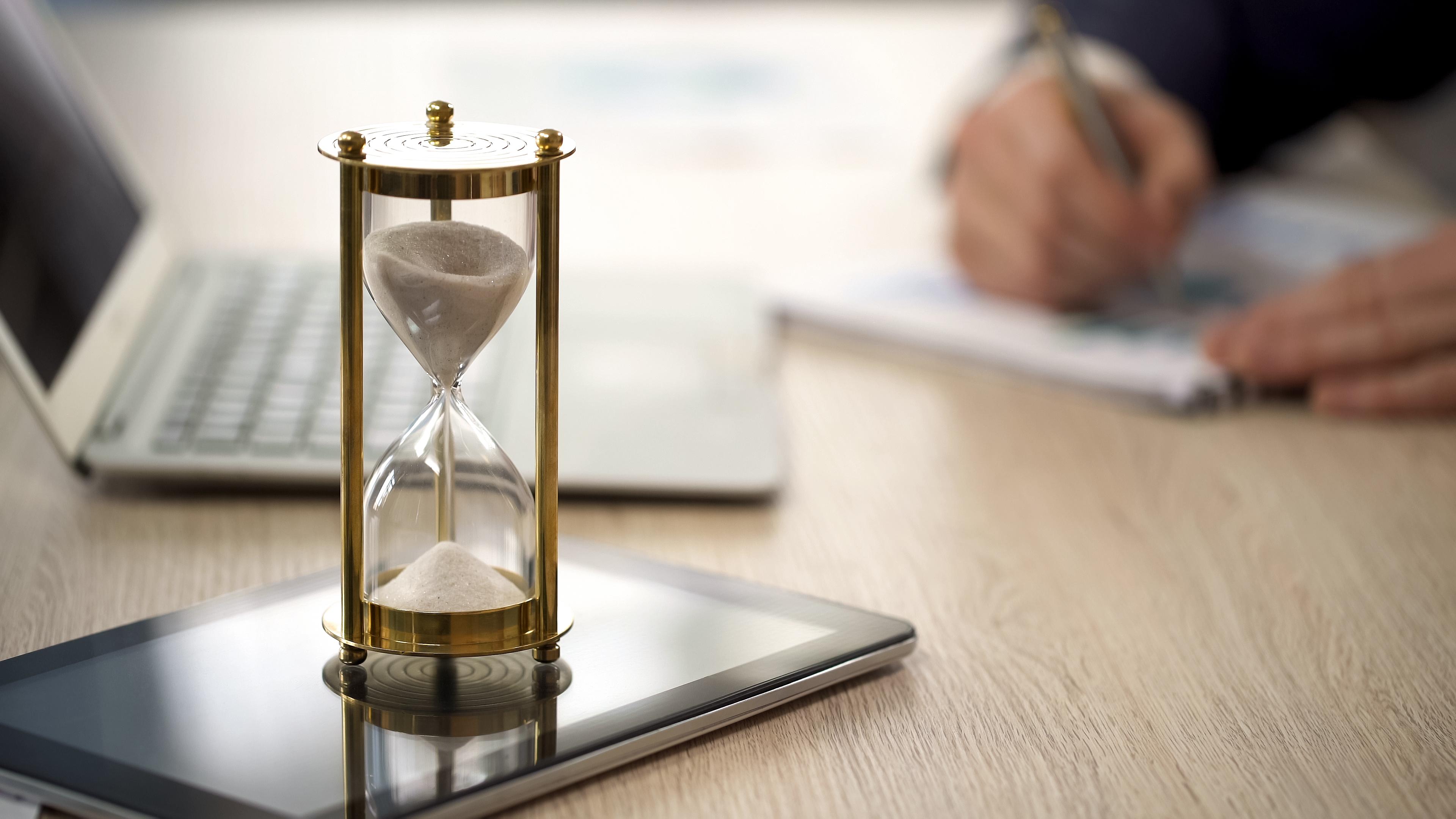 An hourglass on a desk