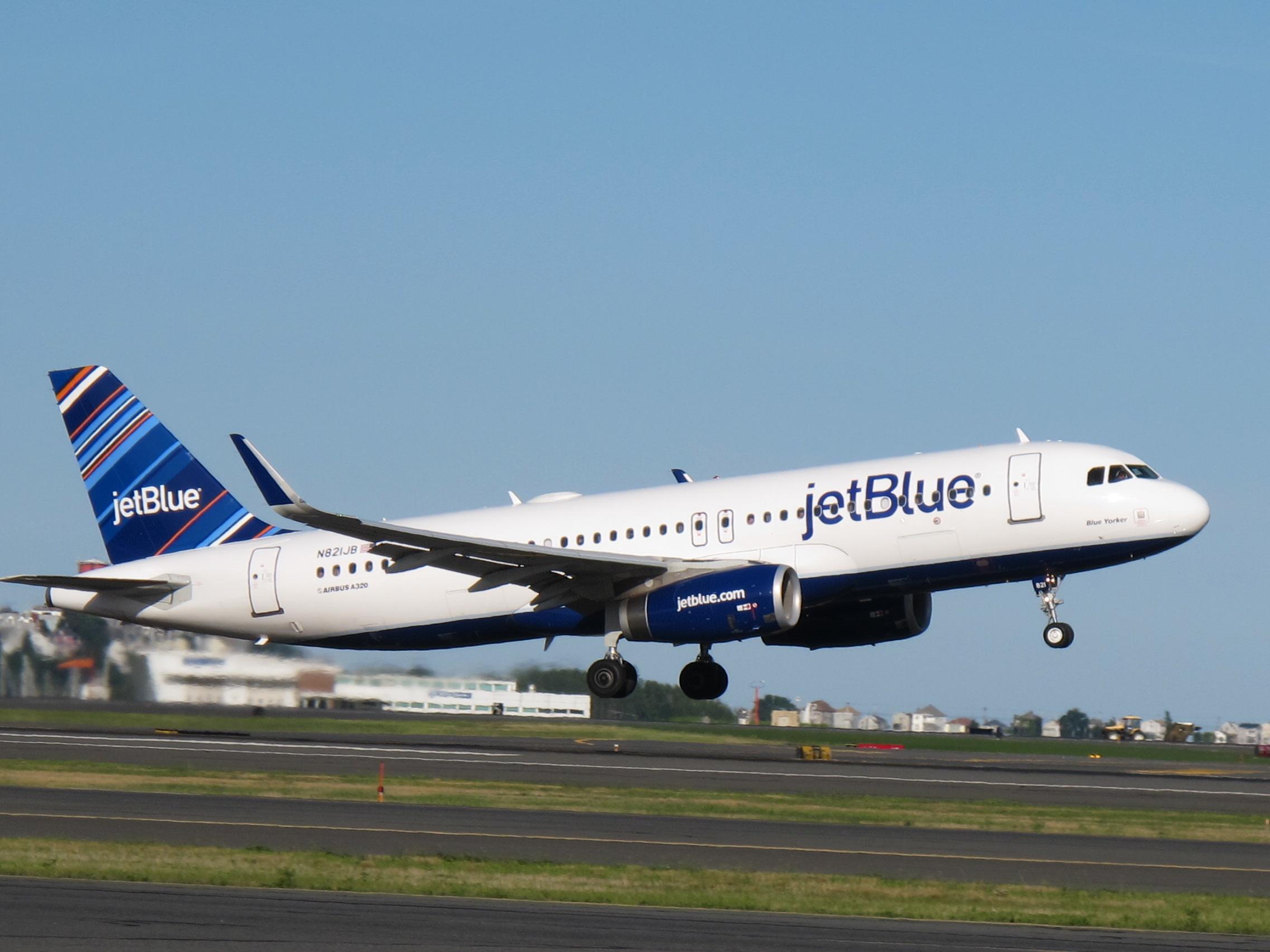 A JetBlue plane taking off.