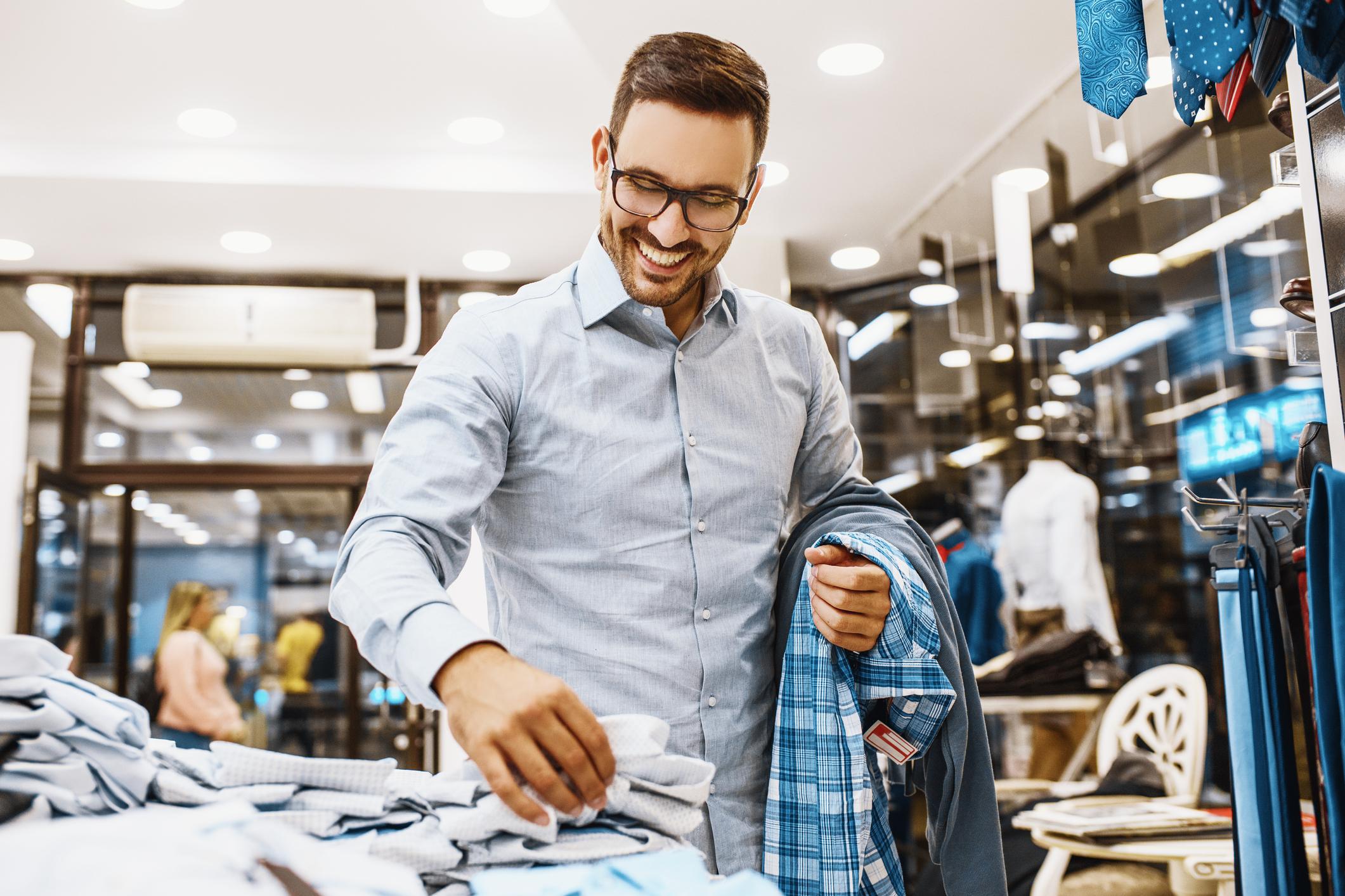 A man shopping in a premium-apparel retail store
