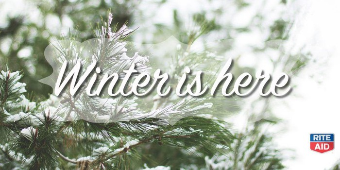 Rite Aid ad with Winter is here written over a snow-covered conifer tree.