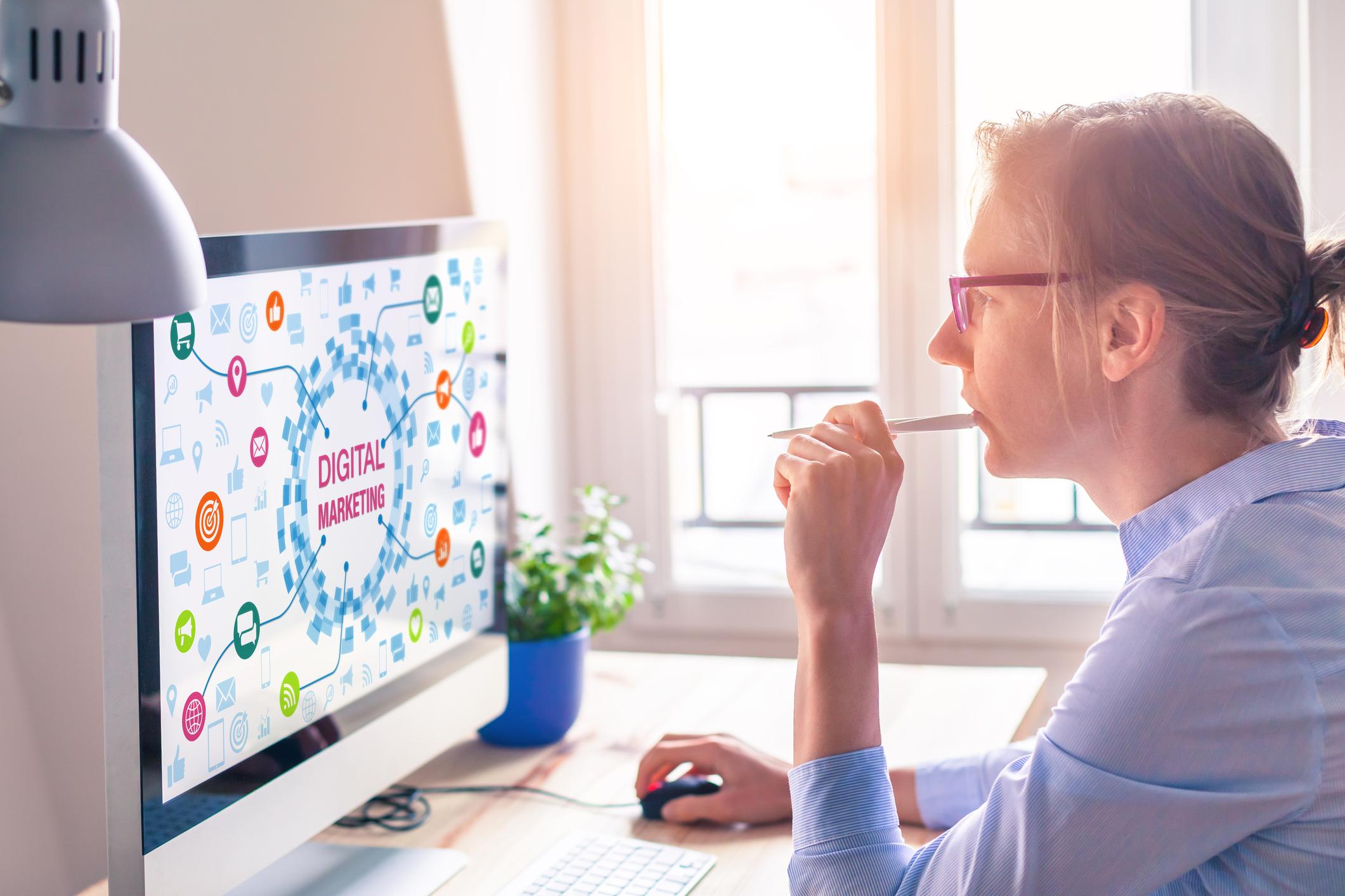 A marketing professional reviews a digital marketing campaign.