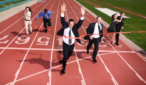 racing-business-people-running-track-getty