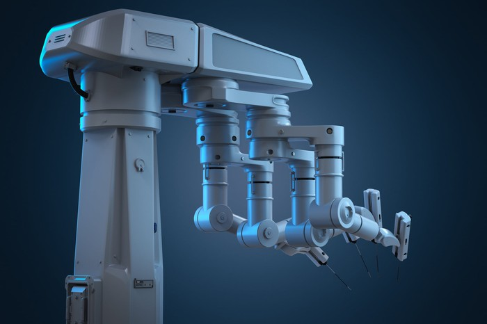 3-D rendering of a robot surgery machine with four arms.