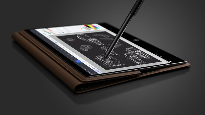 A HP tablet with a stylus pointing to the screen