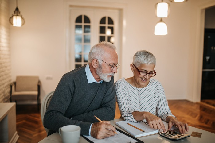 Retired couple looking at finances.