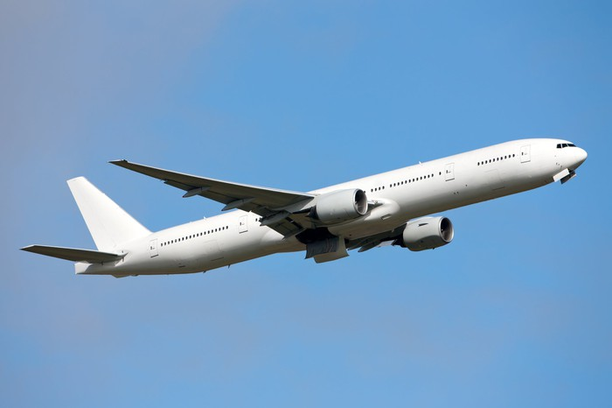 Boeing 777 airliner in flight.