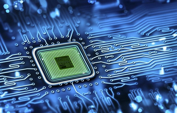 A microchip embedded in a circuit board.