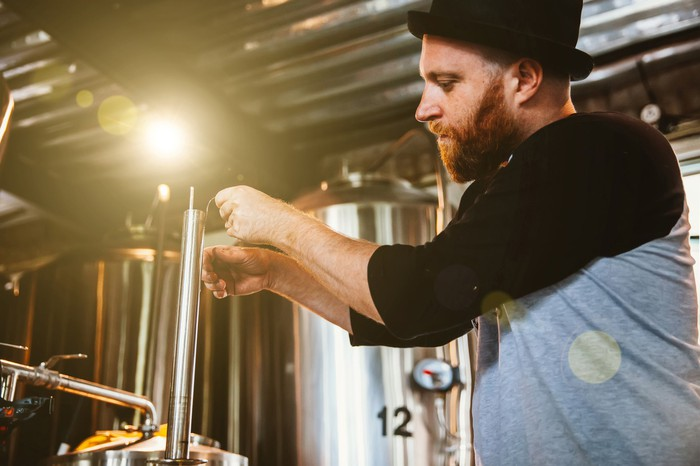 Craft brewer sampling his beer.