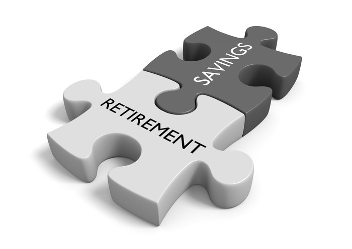 Puzzle piece with the word retirement interlocked with puzzle piece with the word savings