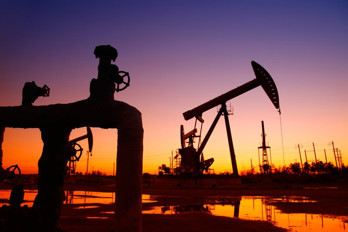 A pipeline and an oil pump at sunset