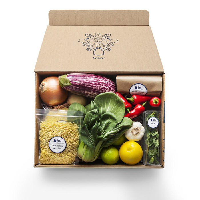 A Blue Apron box with ingredients inside