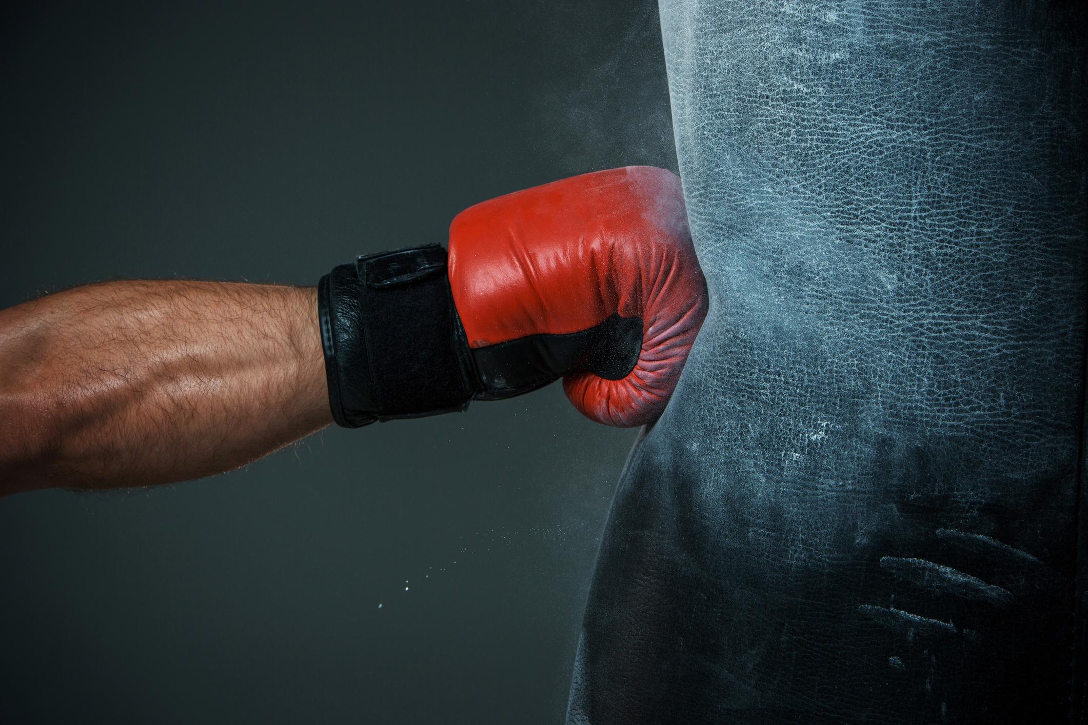 A man punching a bag.