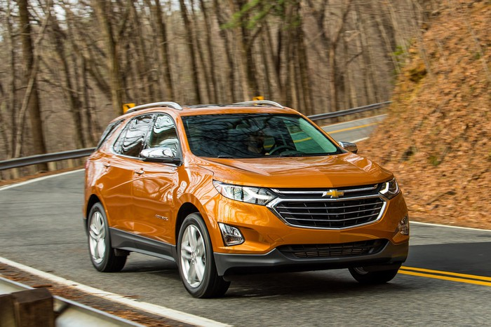 An Orange Chevrolet Equinox A Compact Crossover Suv On Mountain Road