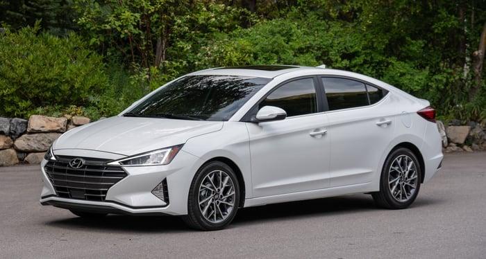 A white Hyundai Elantra, a compact sedan.