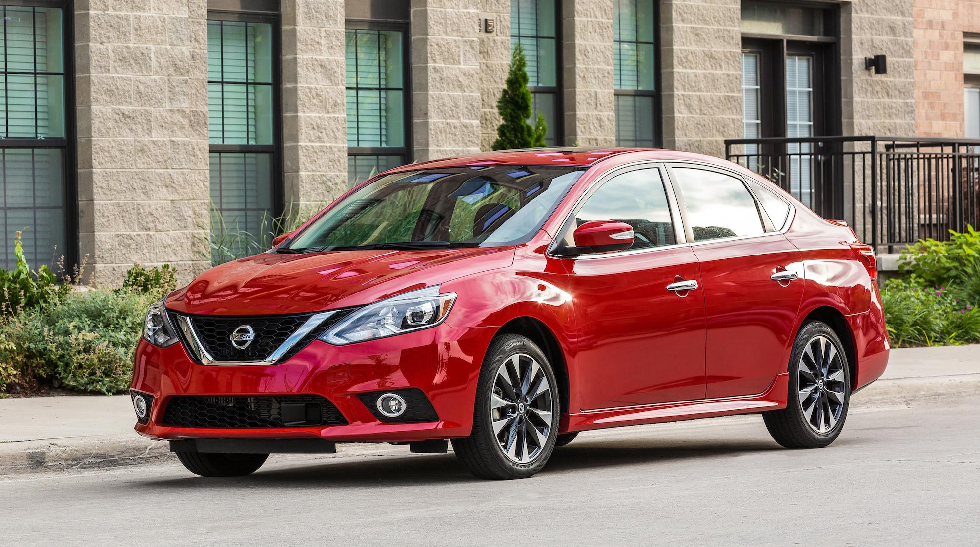 A red Nissan Sentra, a compact sedan.