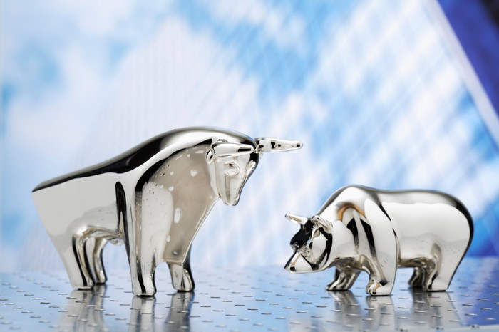 Metal figurines of a bull and a bear.