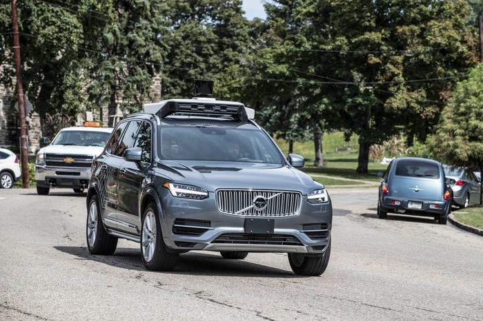 A self-driving Uber SUV on the road.