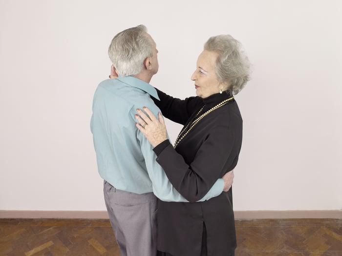 Senior man and woman dancing