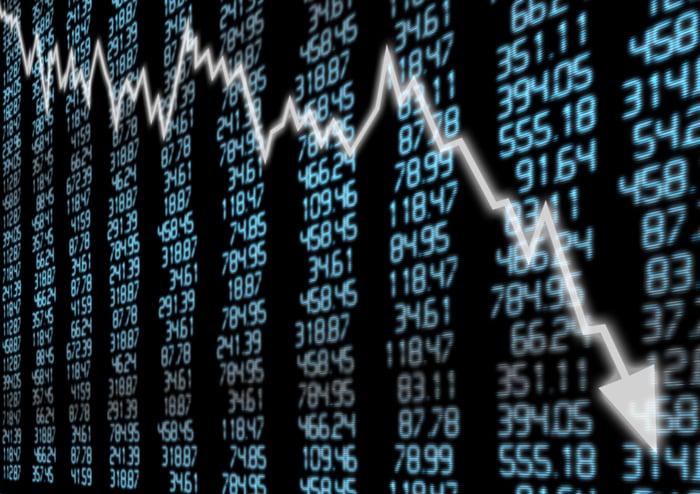Downward trend arrow over stock symbols.
