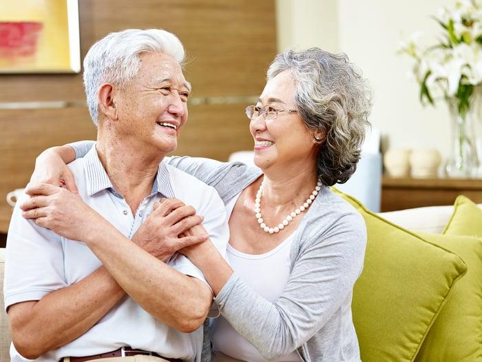 an older couple hugging