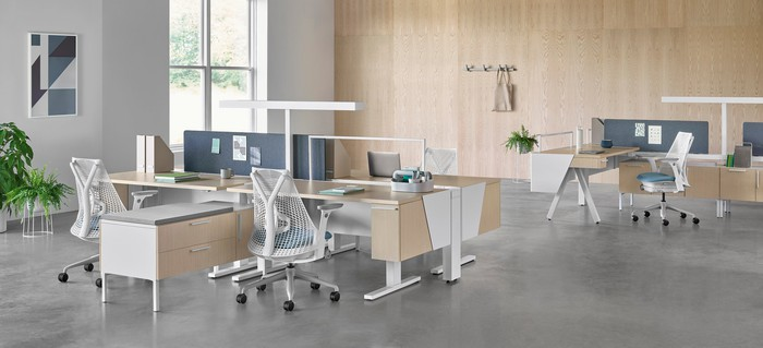 Herman Miller office furniture arranged in a large contemporary workspace.